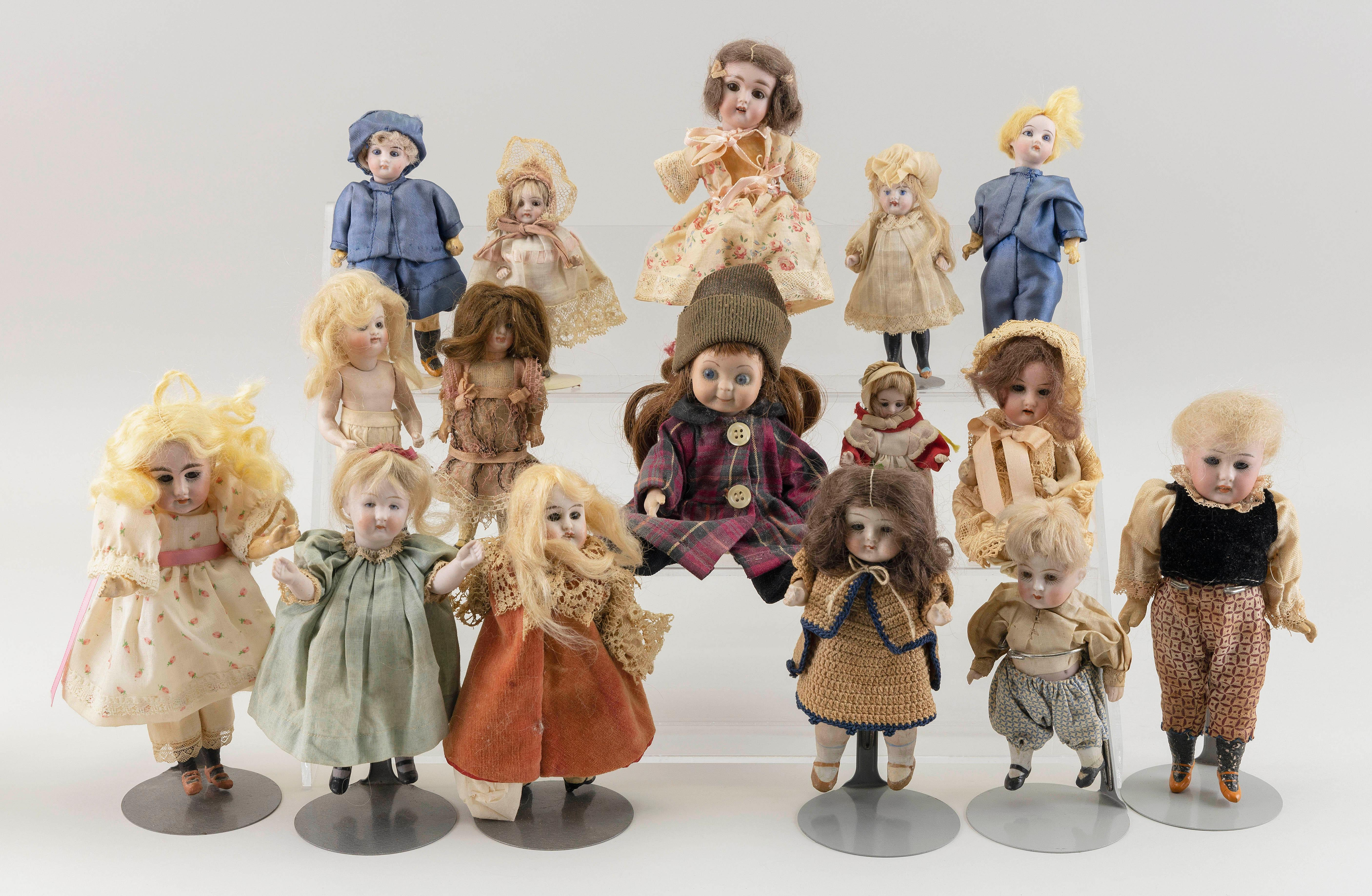 """SIXTEEN SMALL GERMAN BISQUE DOLLS 20th Century Heights from 3"""" to 8""""."""