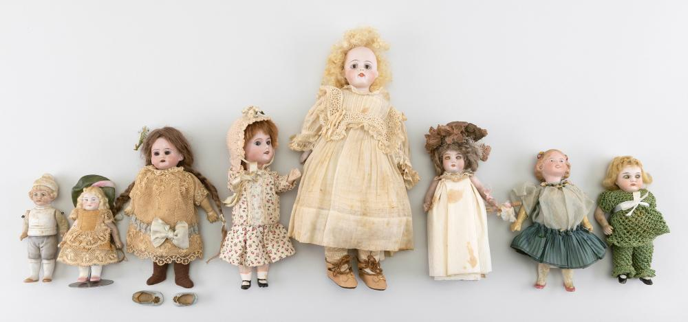 """EIGHT GERMAN BISQUE DOLLS Circa 1910 Heights from 4"""" to 10""""."""
