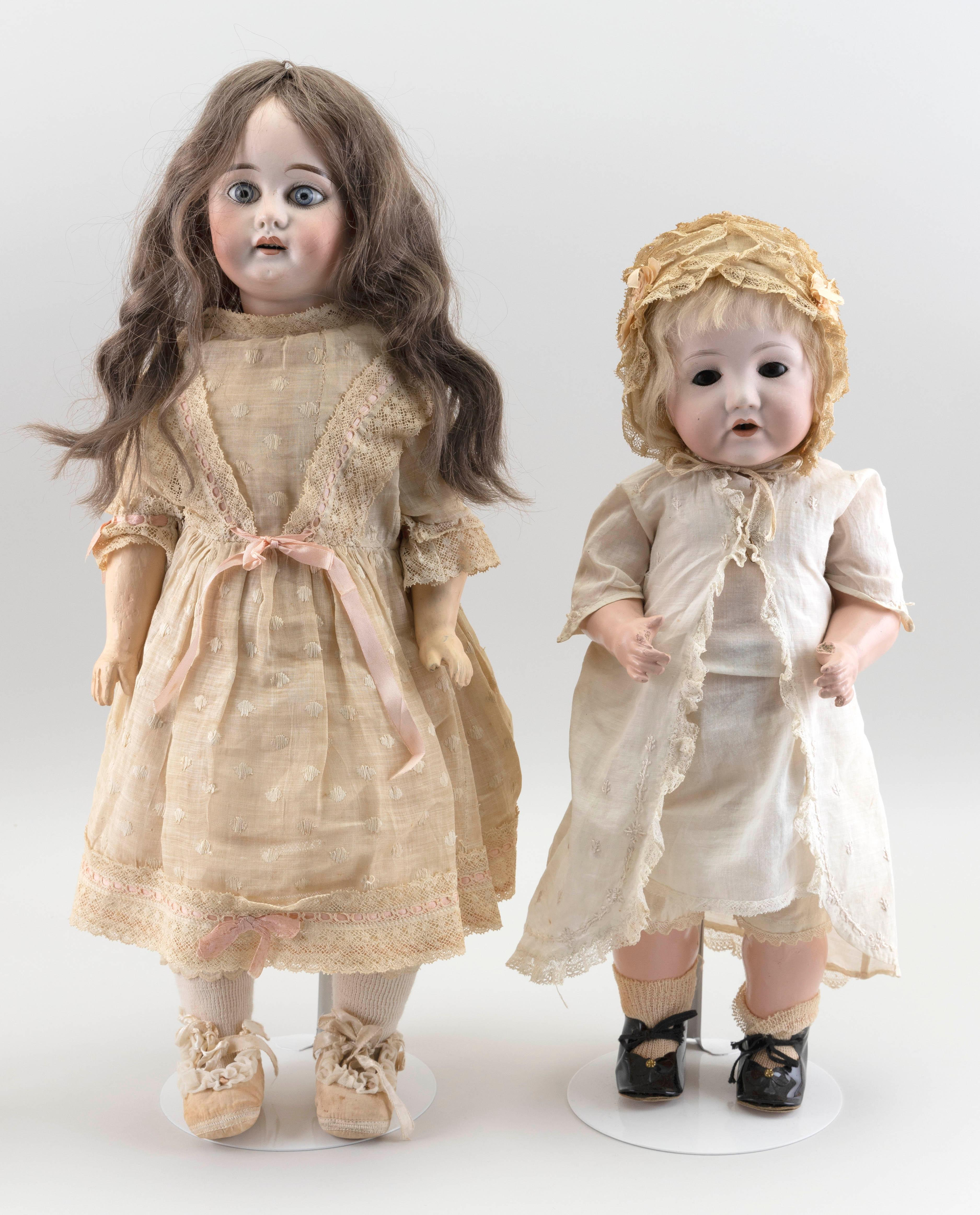 """TWO GERMAN BISQUE-HEAD DOLLS 20th Century Heights 18"""" and 22""""."""
