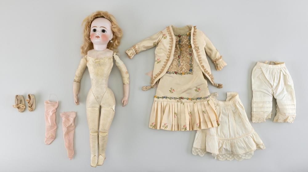 "GERMAN BISQUE-HEAD DOLL Circa 1890 Height 16""."