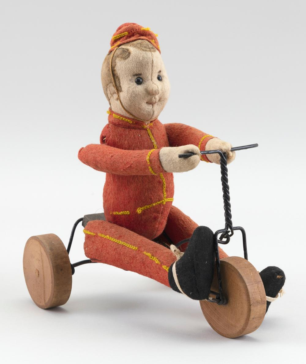 """GERMAN FELT BOY FIGURE ON A TRICYCLE 20th Century Height 9""""."""