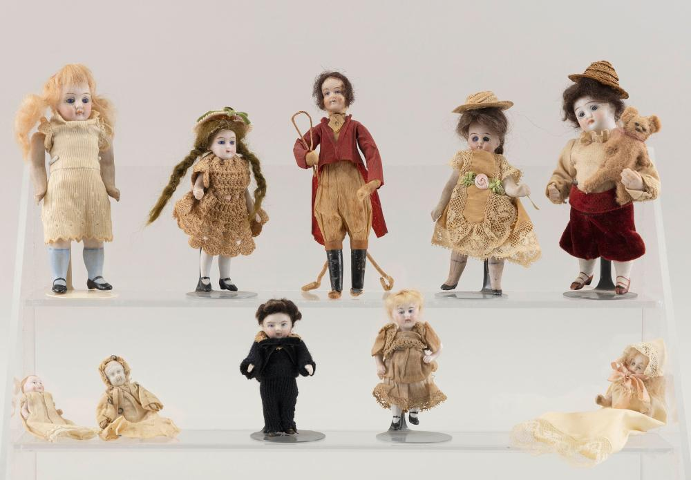 """TEN SMALL GERMAN BISQUE DOLLS Circa 1910 Heights from 2"""" to 5""""."""