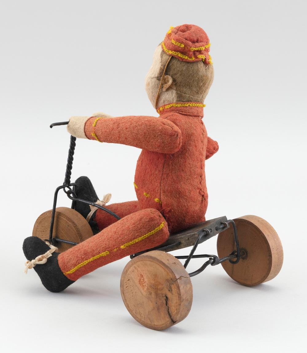 GERMAN FELT BOY FIGURE ON A TRICYCLE 20th Century Height 9