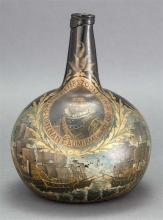 BLOWN GLASS BOTTLE WITH PAINTED DECORATION Olive green bottle with portrait of