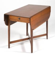 ANTIQUE AMERICAN HEPPLEWHITE PEMBROKE TABLE In cherry. Rectangular drop-leaf top with ovolo corners. Single drawer at one end of apr...