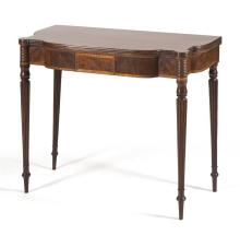 ANTIQUE AMERICAN SHERATON CONSOLE CARD TABLE In mahogany. Dramatically shaped top set on a conforming apron with central rectangular...