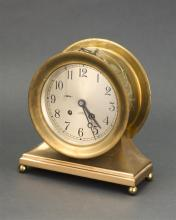 CHELSEA SHIP''S CLOCK Brushed steel case and brass base. Height 9