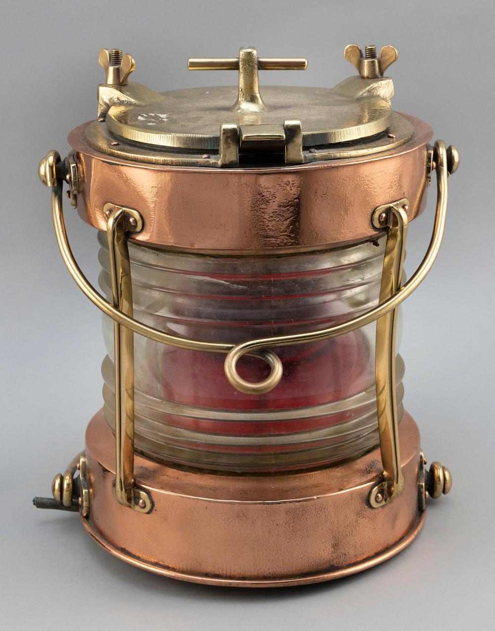 """BRASS AND COPPER MASTHEAD LIGHT Early 20th Century Total height 25"""". Diameter approx. 12""""."""