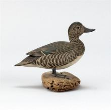 """JAMES LAPHAM MINIATURE GREEN-WINGED TEAL HEN In standing form with turned head. Mounted on a driftwood base. Signed """"J. Lapham Denni..."""