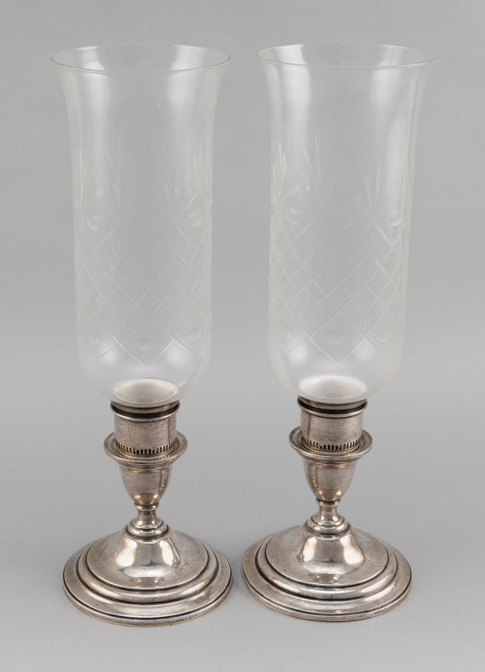 """PAIR OF INTERNATIONAL STERLING """"LORD SAYBROOK"""" WEIGHTED STERLING SILVER CANDLESTICKS WITH CUT GLASS HURRICANES 20th Century"""