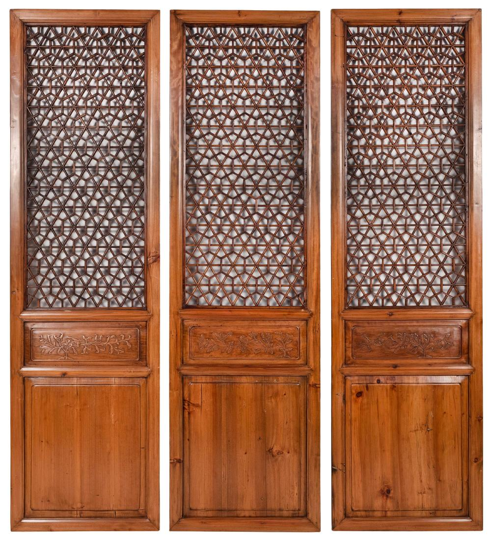 """THREE CHINESE CARVED PINE PANELS 20th Century Heights 79.5"""". Widths 22.5"""". Depths 1.5""""."""