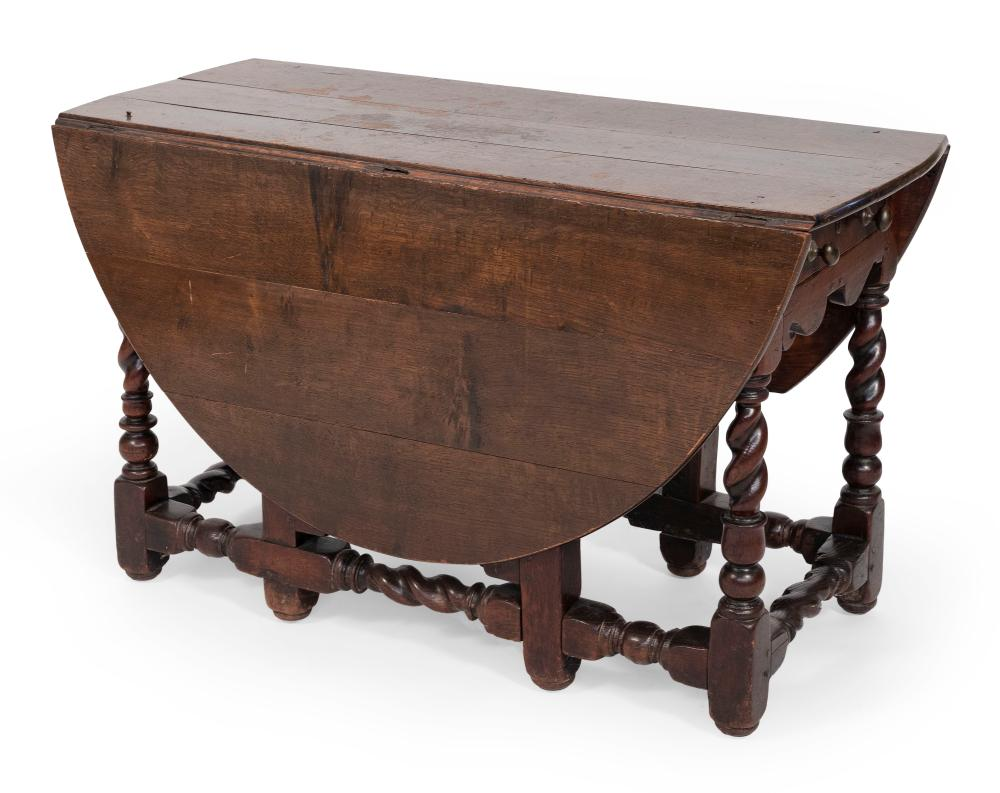 """GATE-LEG DROP-LEAF TABLE England, Early 18th Century Height 29"""". Length 46.5"""". Width 20"""" plus two 21.5"""" demilune drop leaves."""