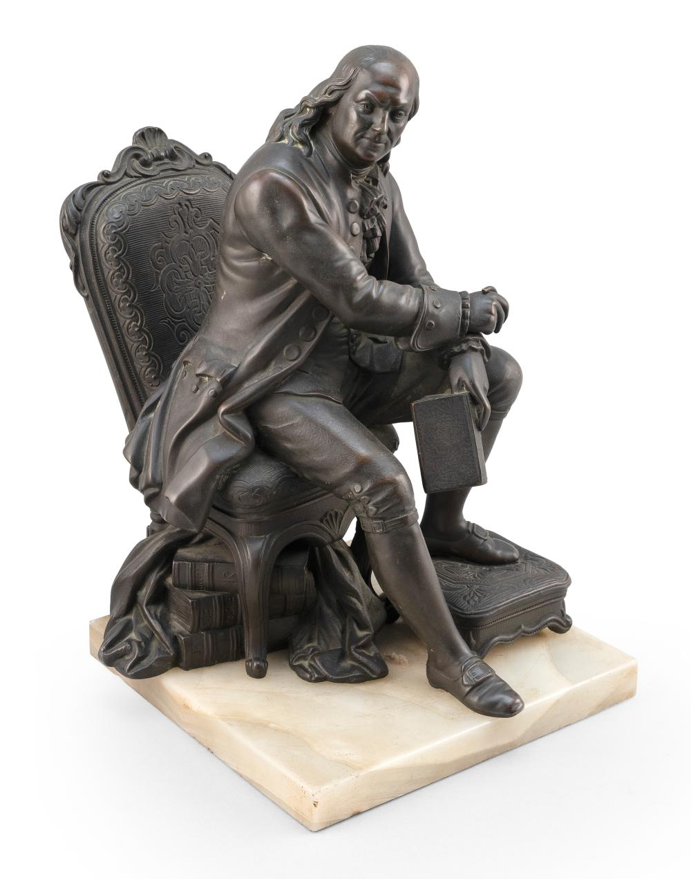 """METAL SCULPTURE OF A SEATED BENJAMIN FRANKLIN Late 19th Century Patinated white metal on a white marble base, height 13""""."""