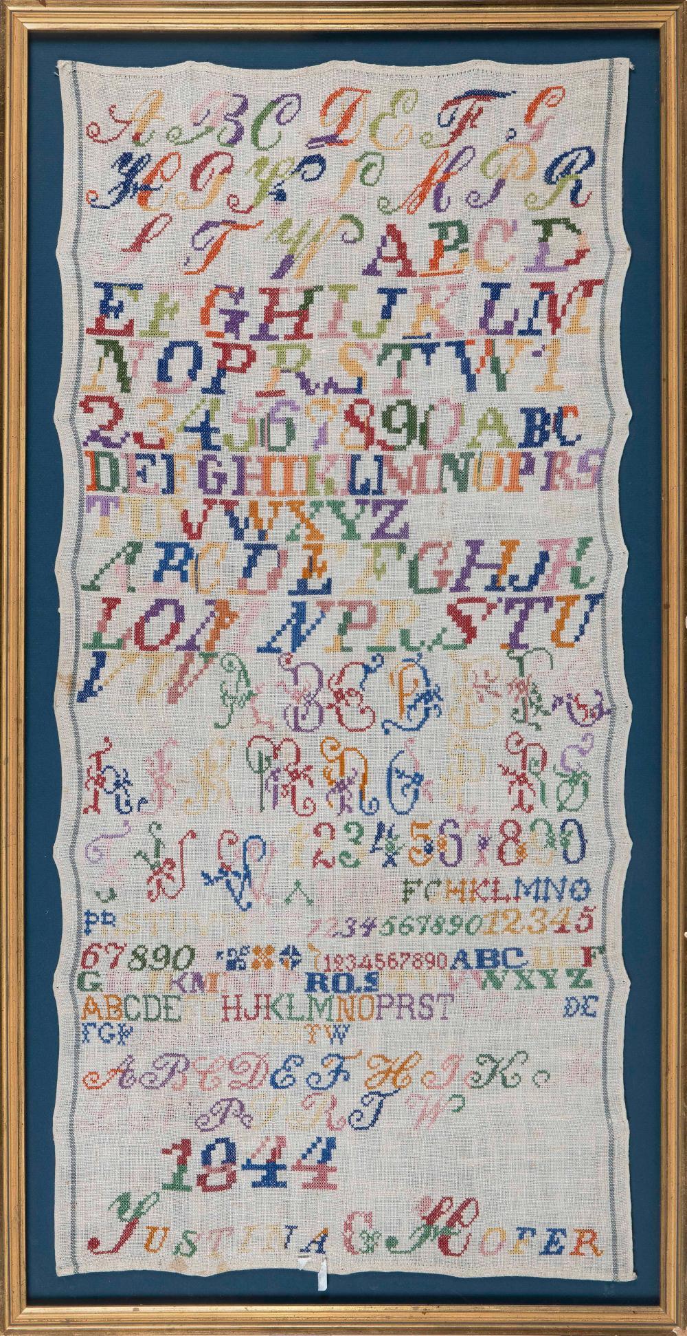 "ENGLISH NEEDLEWORK SAMPLER Dated 1844 37"" x 17"". Framed 41"" x 21""."