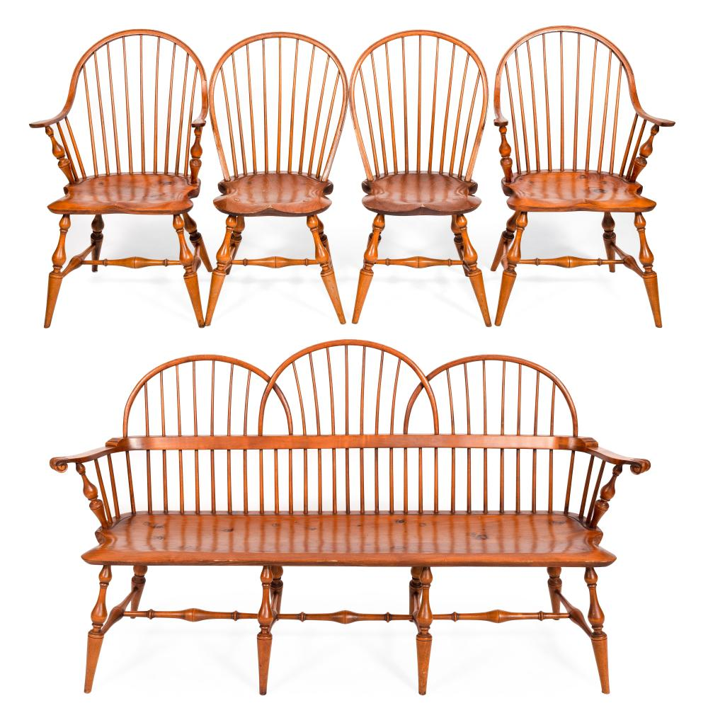 """ELDRED WHEELER WINDSOR-STYLE BENCH AND FOUR BOWBACK WINDSOR CHAIRS Massachusetts, 20th Century Bench back height 39.5"""". Seat height 17"""". Length 72"""". Chair seat heights 18""""."""