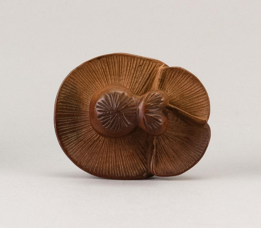 JAPANESE WOOD NETSUKE In the form of three mushrooms. Signed with kakihan. Length 1.5