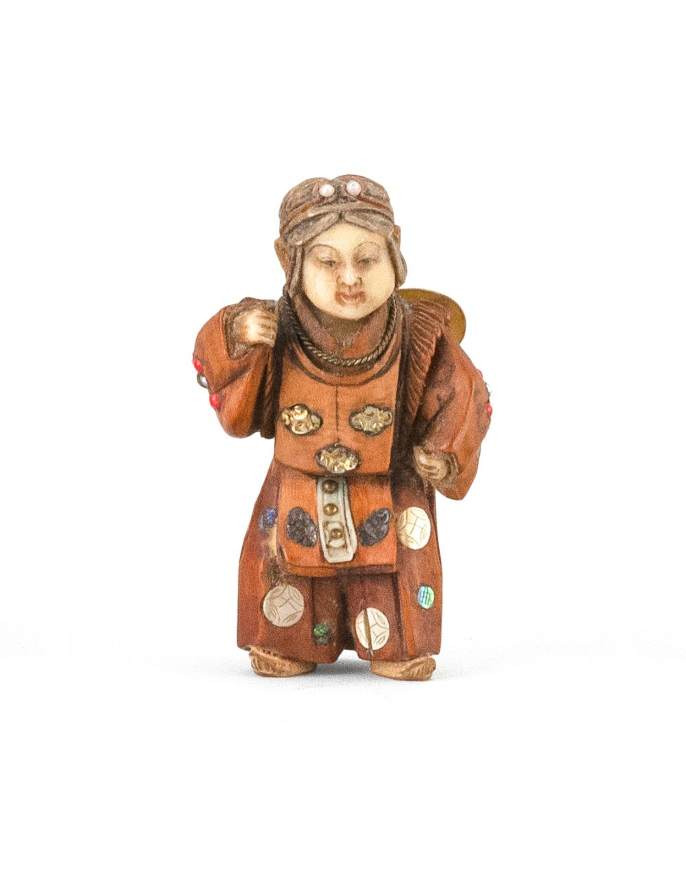 JAPANESE INLAID WOOD NETSUKE In the form of a butterfly dancer, with mother-of-pearl, gold, coral, bone and lapis lazuli inlay. Repl...