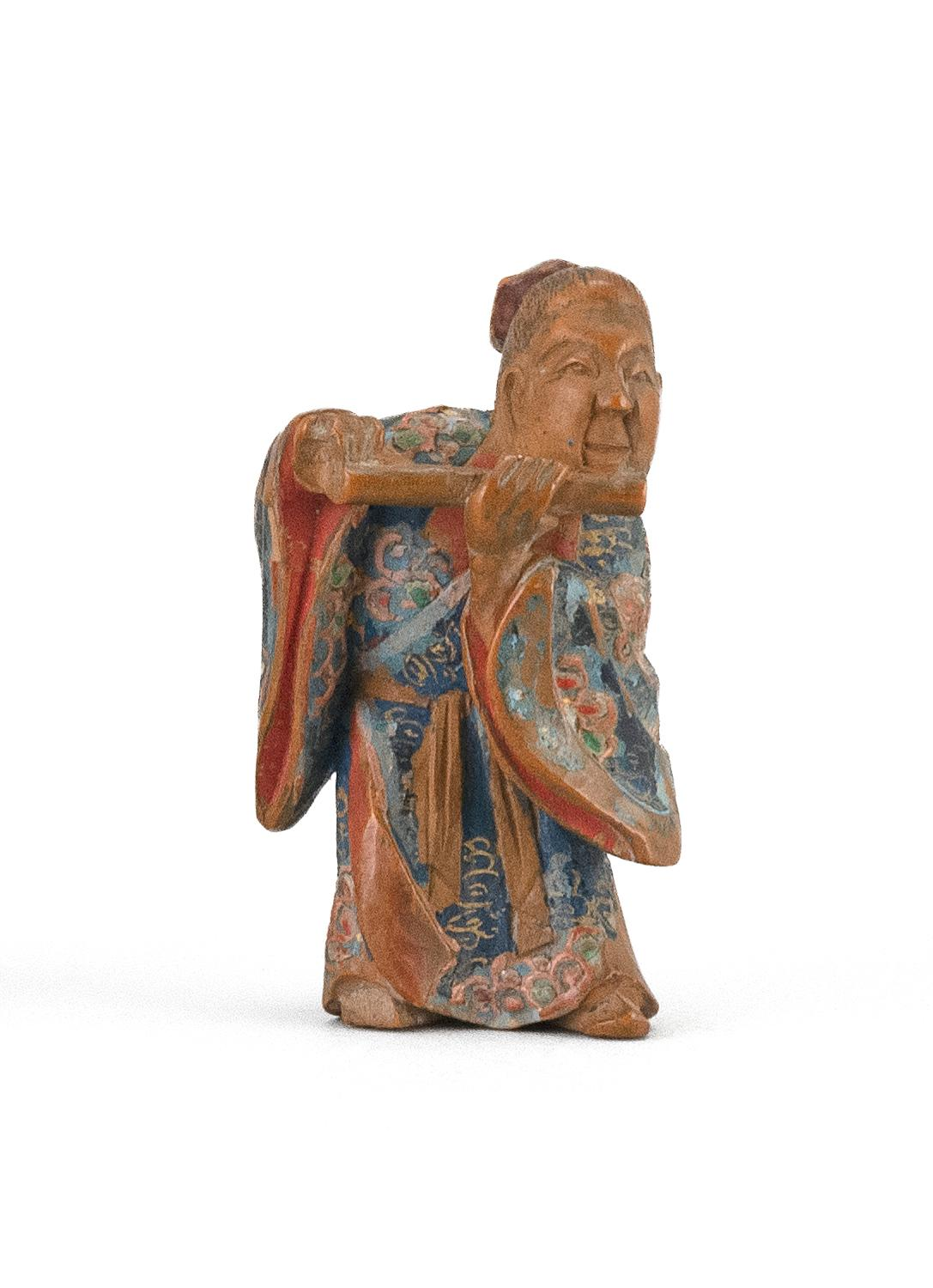 """JAPANESE POLYCHROME WOOD NETSUKE By Nagamachi Shuzan. In the form of a scholar playing a flute. Height 1.75""""."""