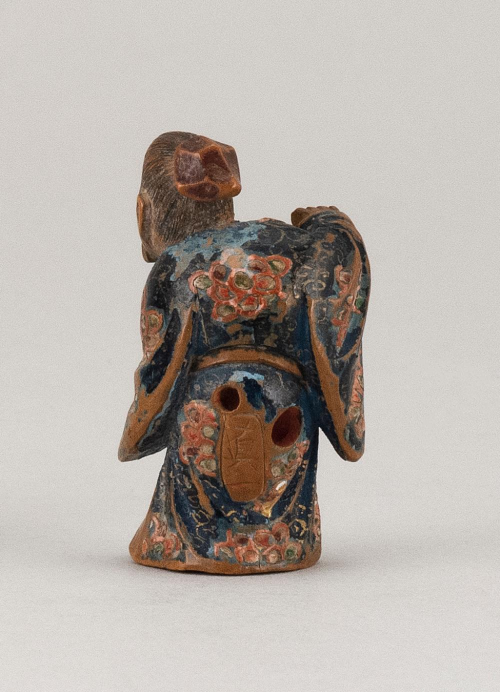 JAPANESE POLYCHROME WOOD NETSUKE By Nagamachi Shuzan. In the form of a scholar playing a flute. Height 1.75