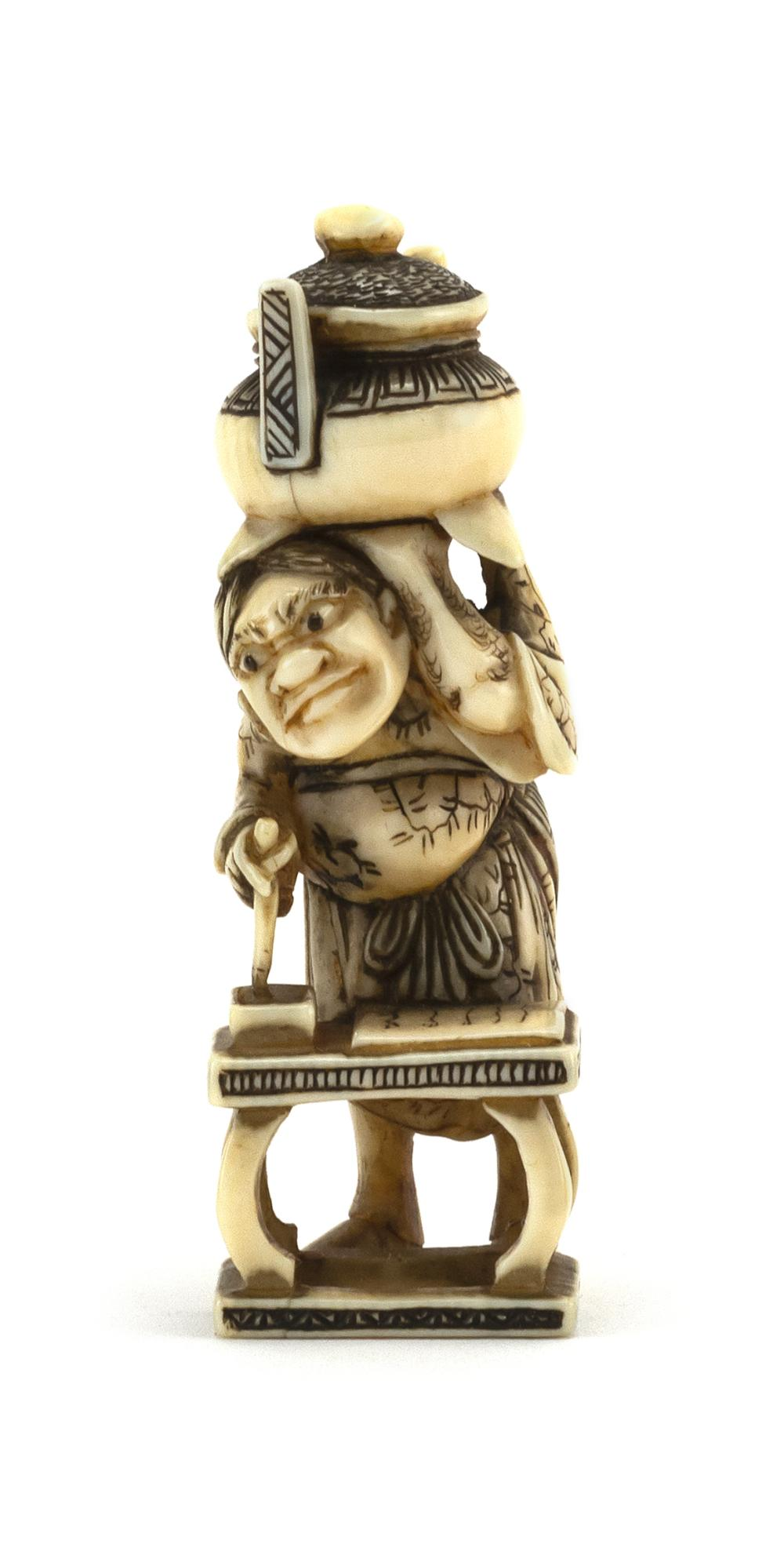 """JAPANESE IVORY NETSUKE In the form of a scholar holding an inkpot on his shoulder. Signed. Height 2.5"""". Not available for internatio..."""