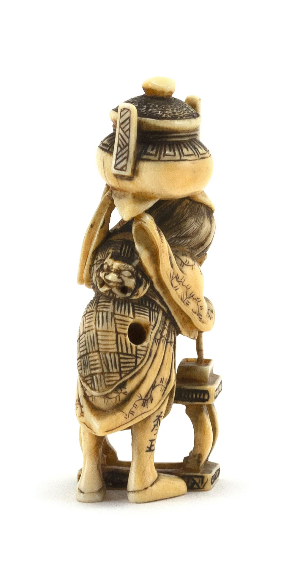 JAPANESE IVORY NETSUKE In the form of a scholar holding an inkpot on his shoulder. Signed. Height 2.5