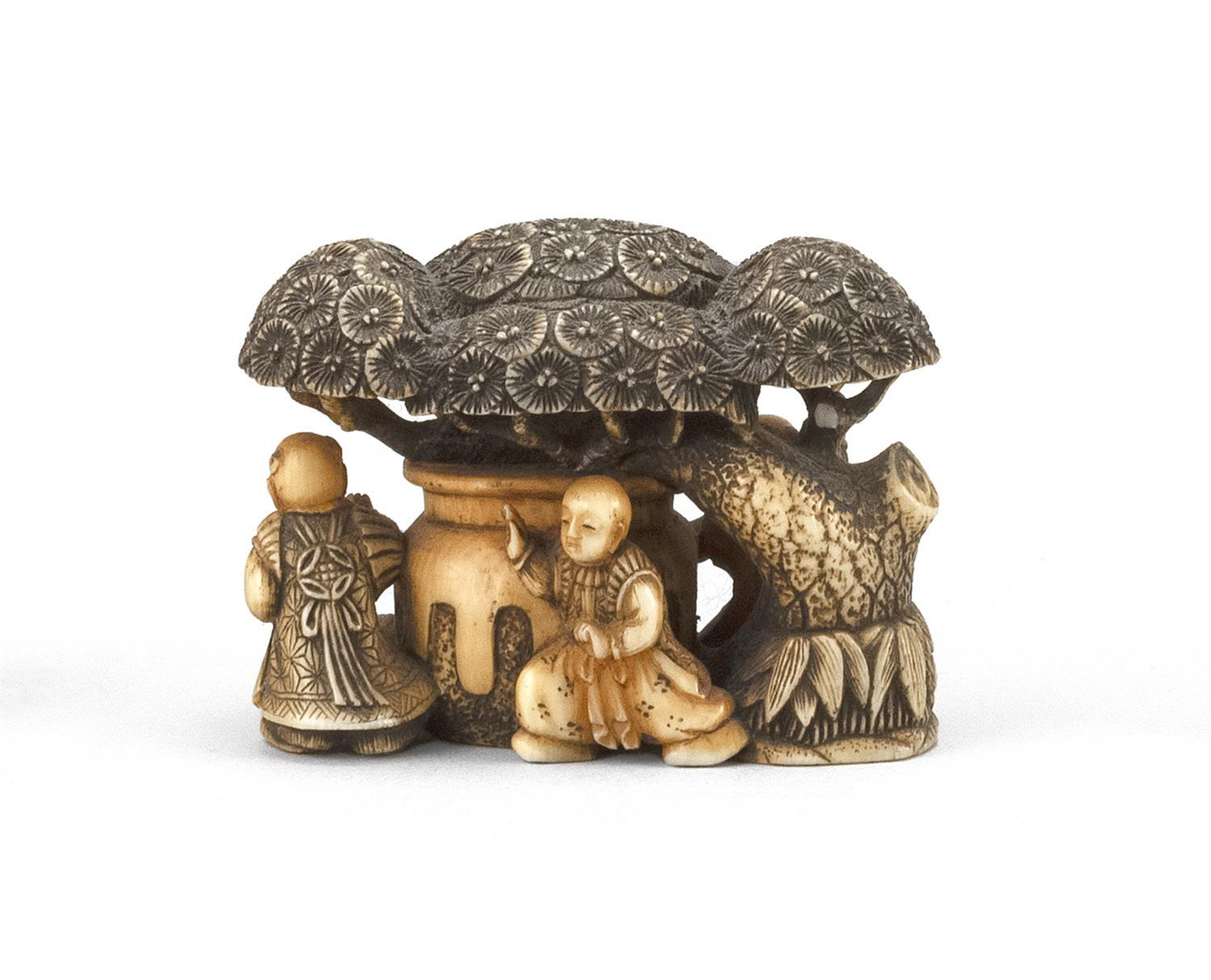 "JAPANESE IVORY NETSUKE/OKIMONO In the form of four men under a tree. Height 1"". Length 2"". Not available for international delivery."