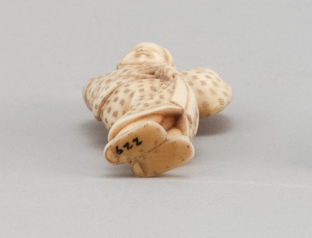 JAPANESE IVORY NETSUKE By Tomochika (1800-1873). In the form of Okame in a dancing pose. Signed. Height 2.3