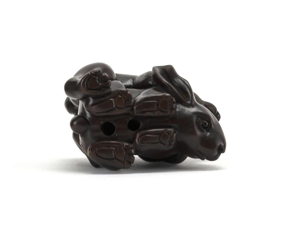 JAPANESE WOOD NETSUKE In the form of two rabbits. Signed. Length 1.75