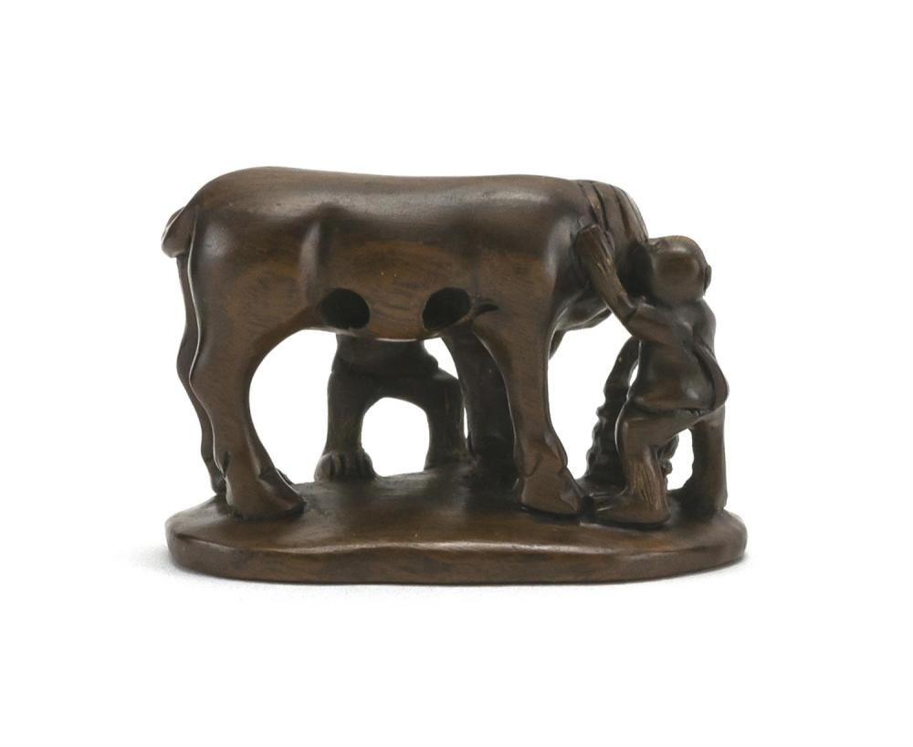 JAPANESE WOOD NETSUKE In the form of a horse being groomed by two monkeys. Signed. Length 2
