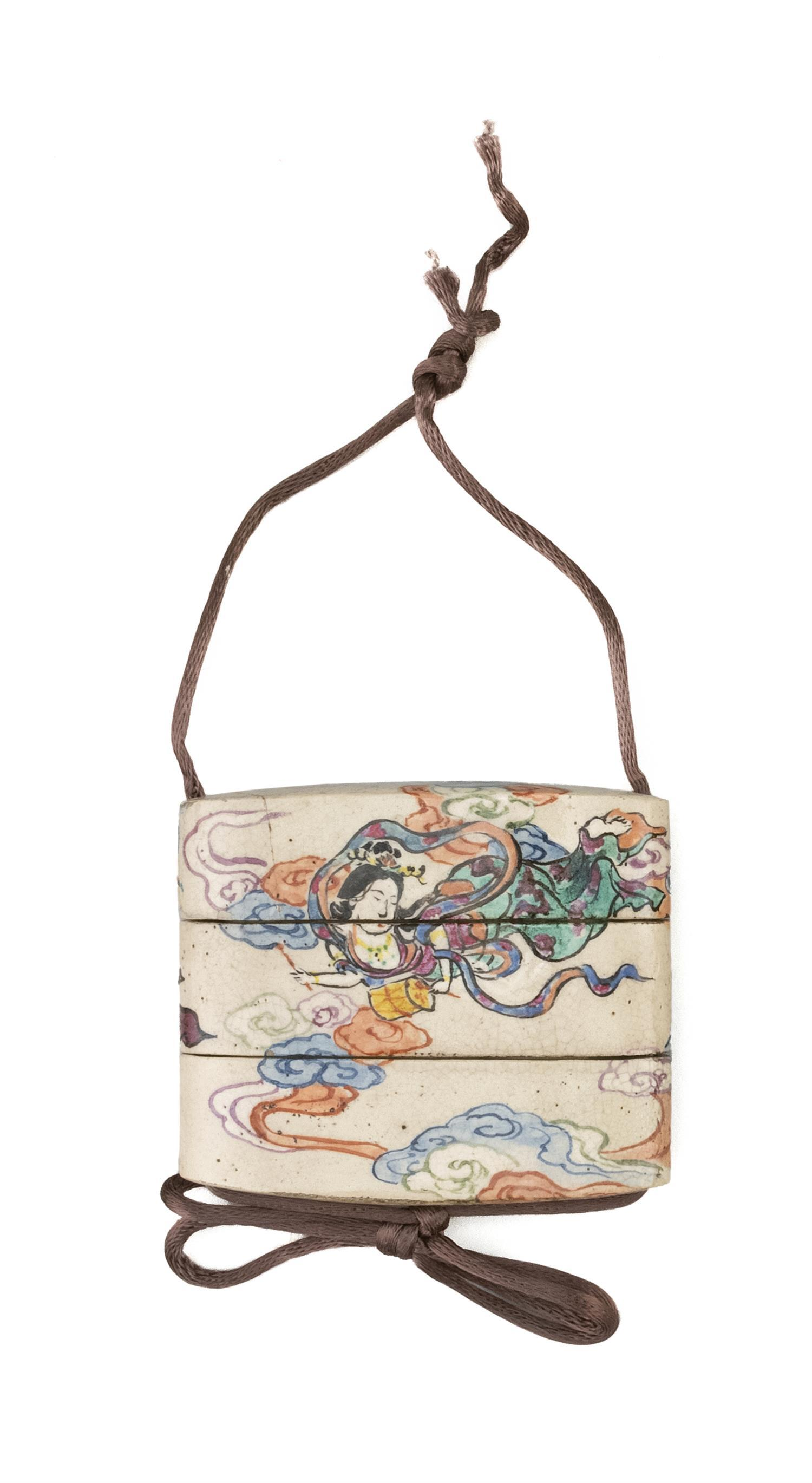 """JAPANESE CERAMIC TWO-CASE INRO Signed Kenzan. Decorated with a polychrome scene of an apsara in clouds playing a shou. Length 2.25""""."""