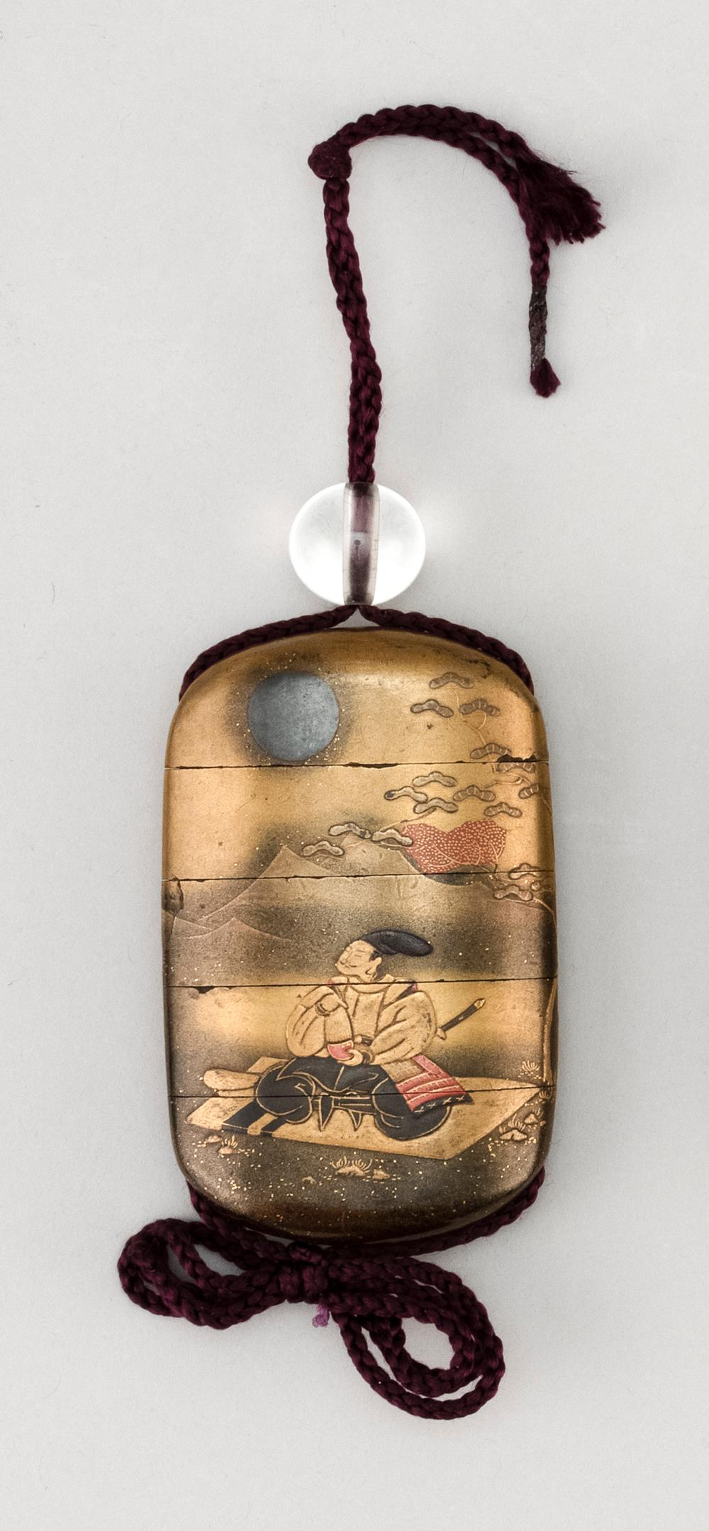JAPANESE GOLD LACQUER FOUR-CASE INRO Decorated with two noblemen in a fall landscape. Length 3.4