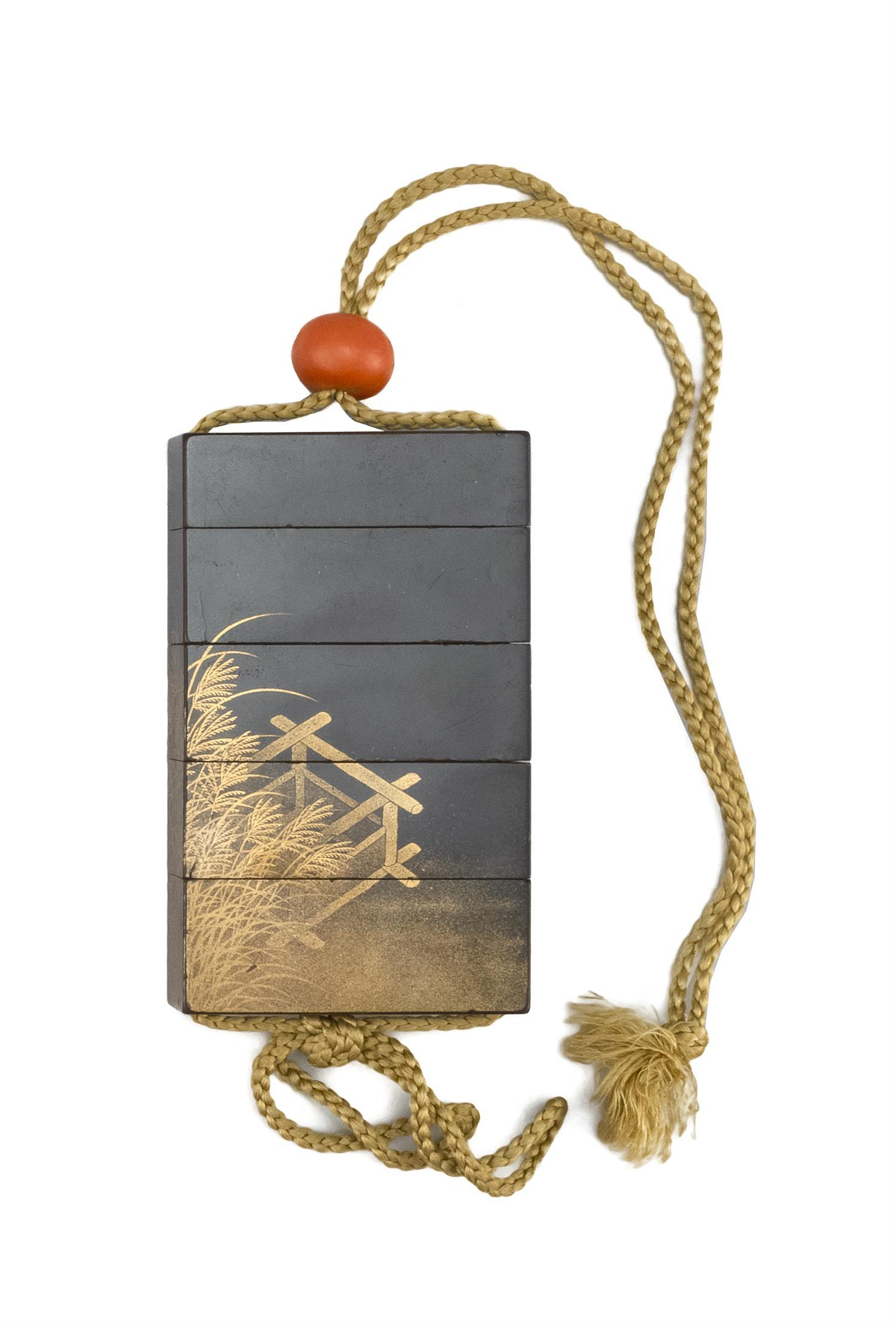 "JAPANESE BLACK AND GOLD LACQUER FOUR-CASE INRO Rectangular, with grasses design. Signed. Length 3.5"". Coral ojime."