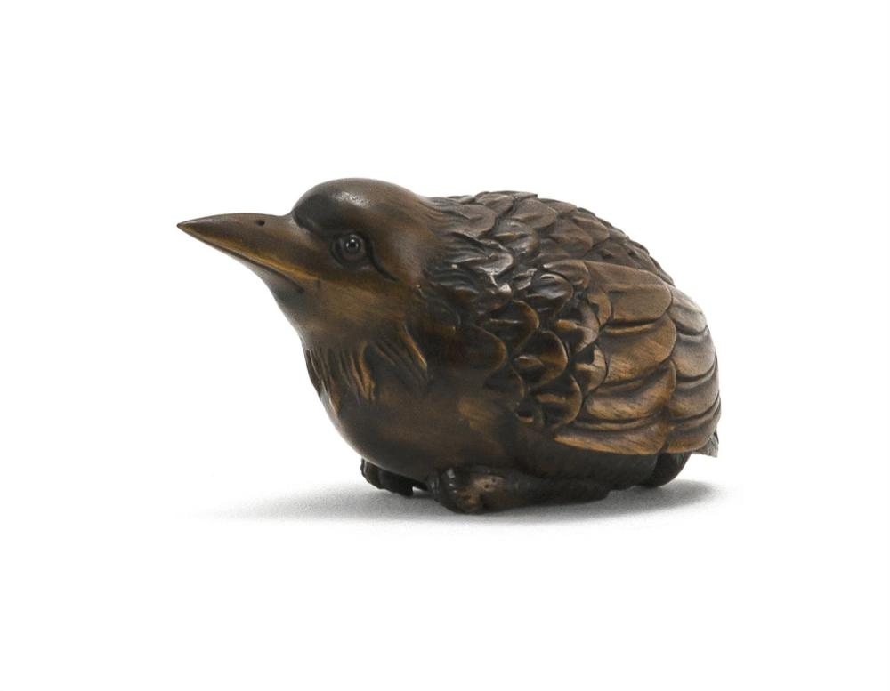 "JAPANESE WOOD NETSUKE In the form of a sparrow. Signed on base. Length 2.5""."