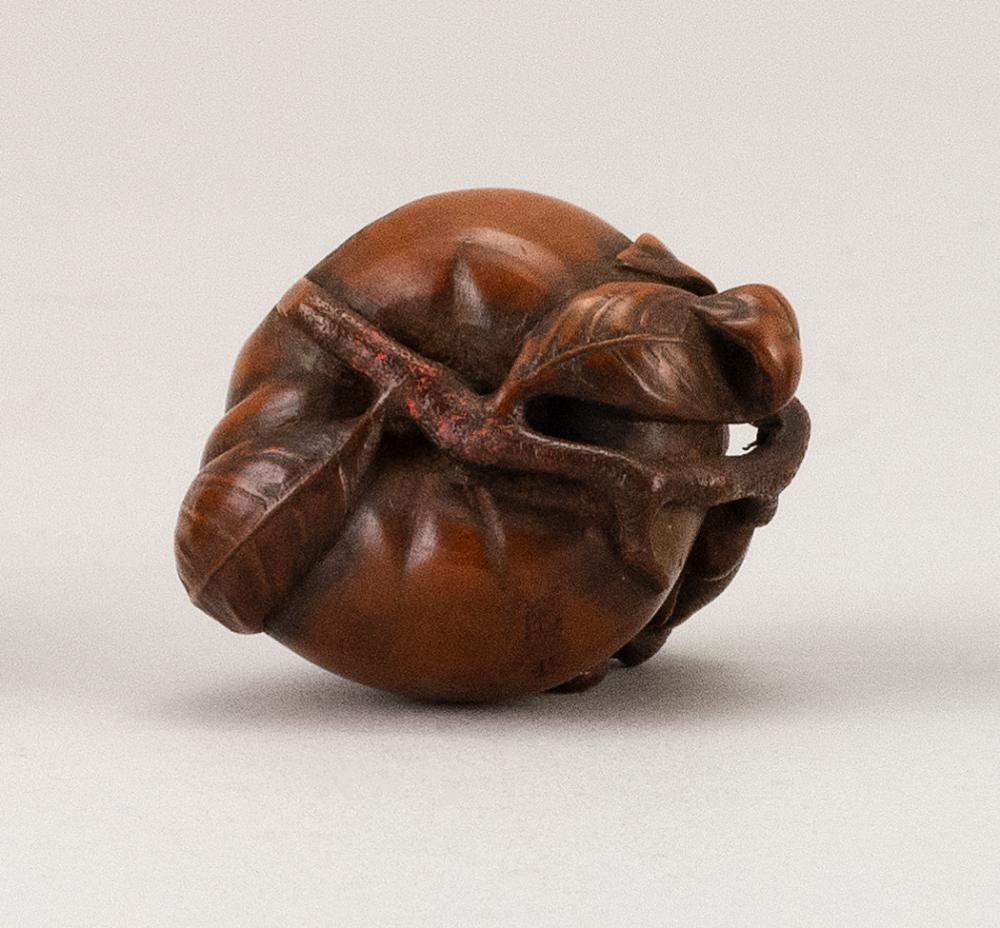 JAPANESE WOOD NETSUKE By Masachika. In the form of two monkeys climbing on a large peach. Signed. Height 1.5