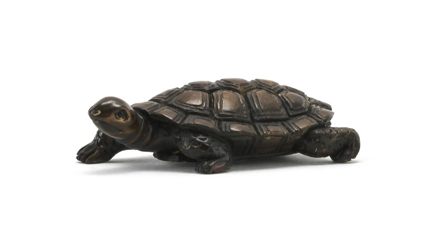 """JAPANESE WOOD NETSUKE In the form of a turtle. Signed on base. Length 2""""."""