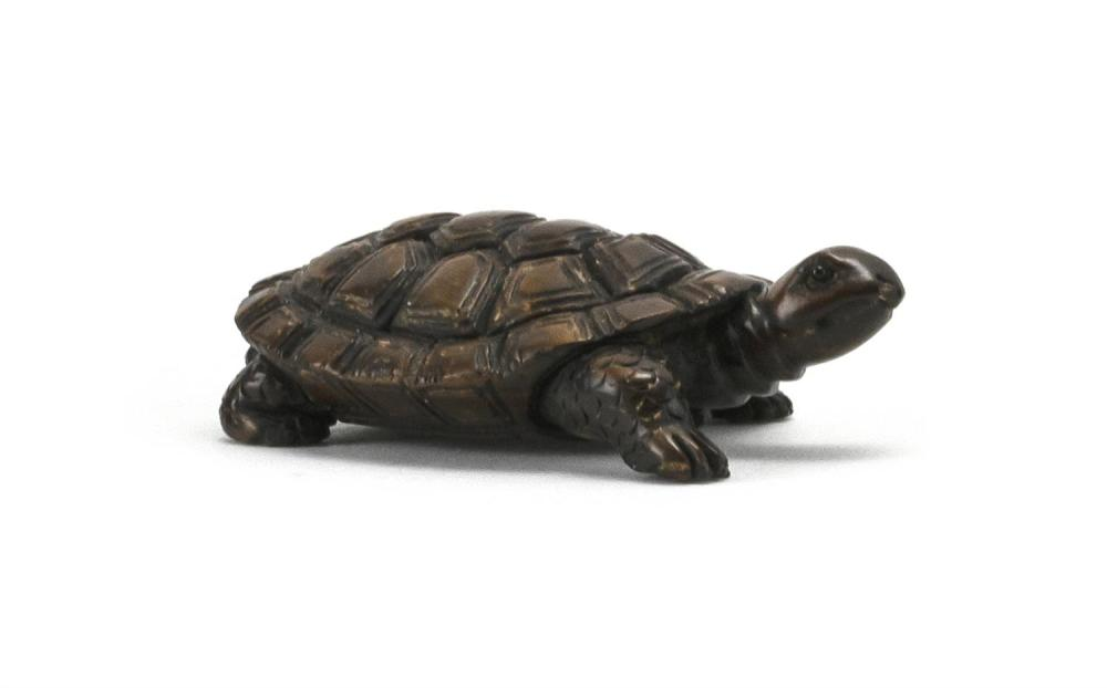 JAPANESE WOOD NETSUKE In the form of a turtle. Signed on base. Length 2