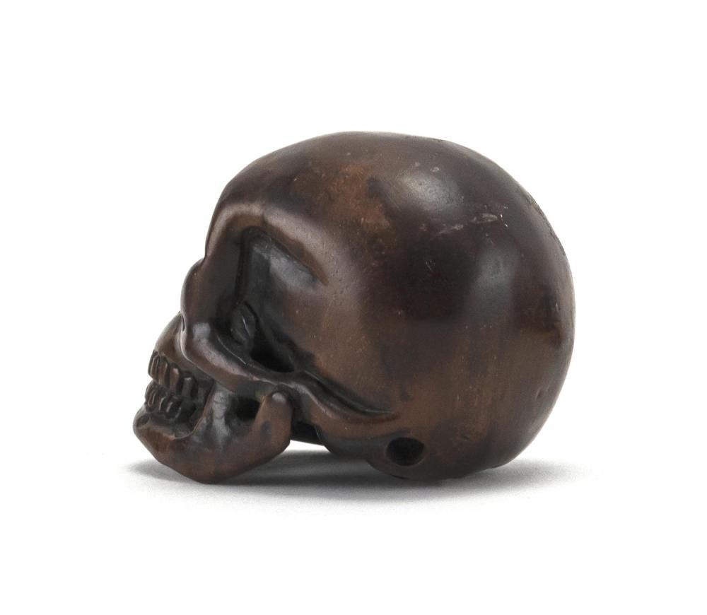 JAPANESE WOOD NETSUKE In the form of a skull. Length 2