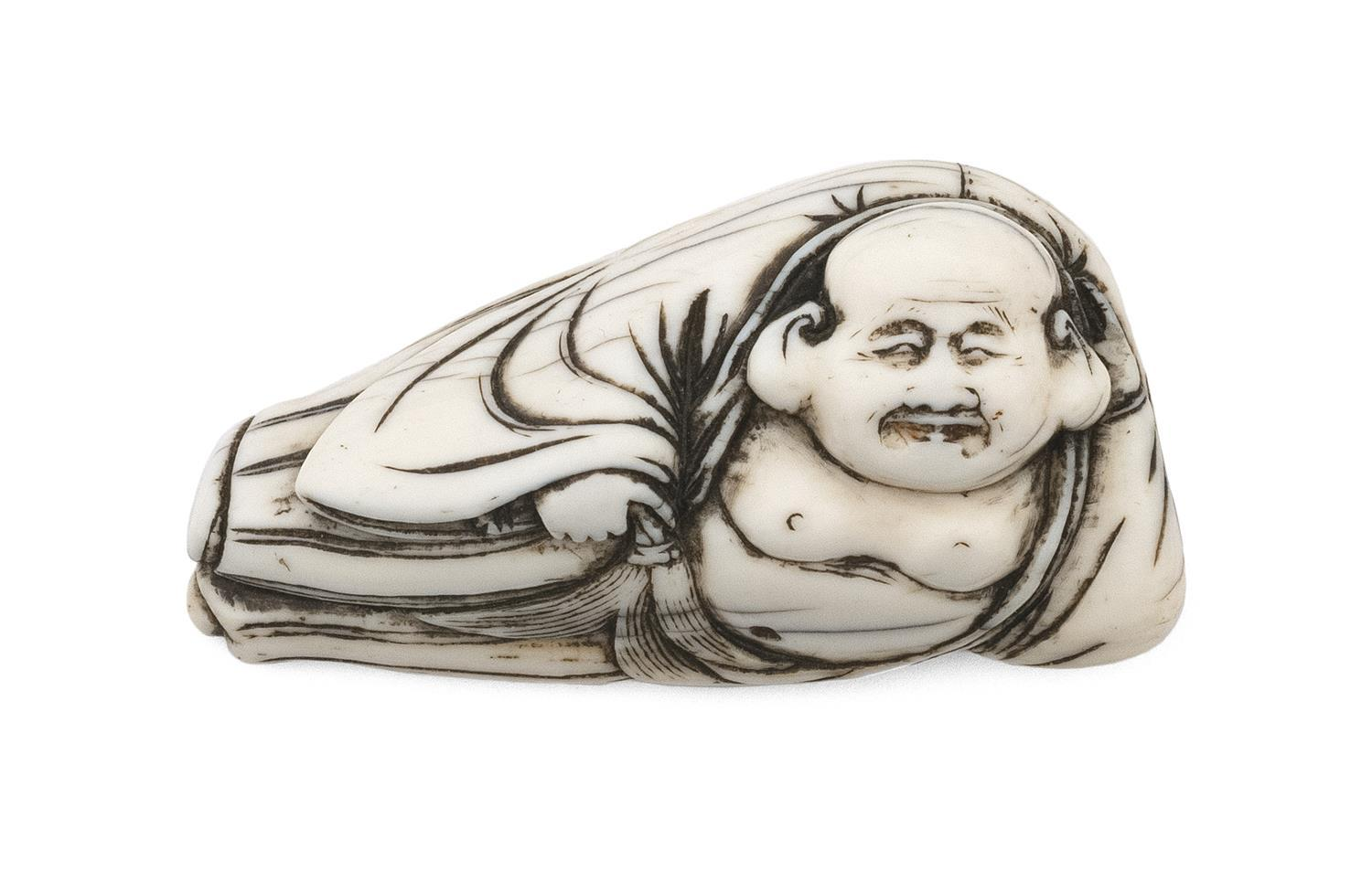 "JAPANESE IVORY NETSUKE In the form of reclining Hoteh holding his treasure sack and a fly whisk. Length 2.5"". Not available for inte..."