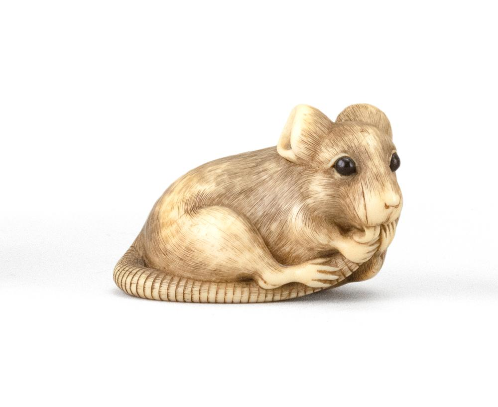 """JAPANESE IVORY NETSUKE In the manner of Okatomo. In the form of a rat with inlaid horn eyes. Length 2"""". Not available for internatio..."""