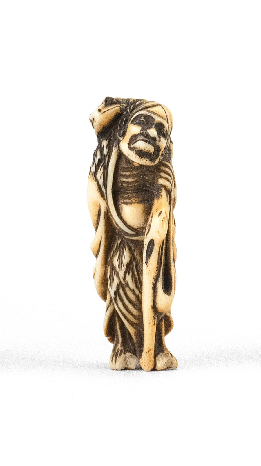 """JAPANESE IVORY NETSUKE In the form of Gama Sennin carrying a large toad on his back. Height 2.1"""". Not available for international de..."""