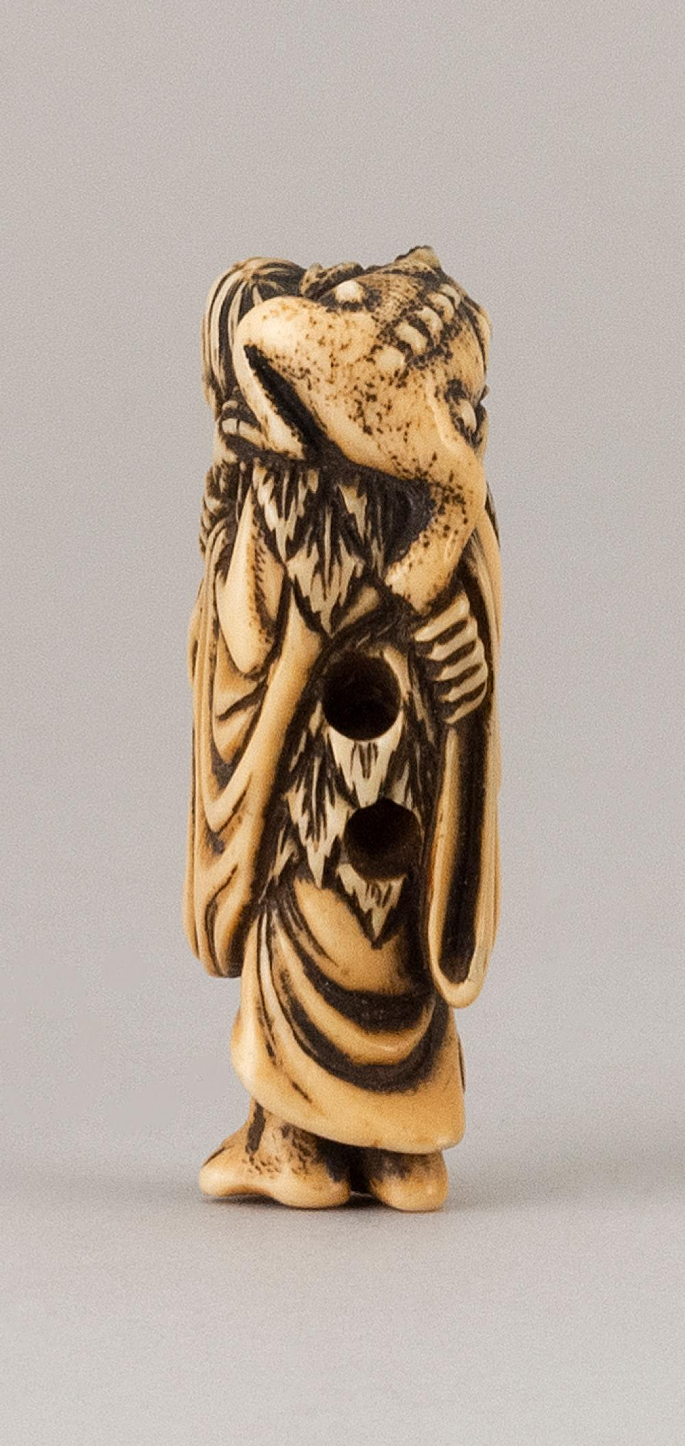 JAPANESE IVORY NETSUKE In the form of Gama Sennin carrying a large toad on his back. Height 2.1