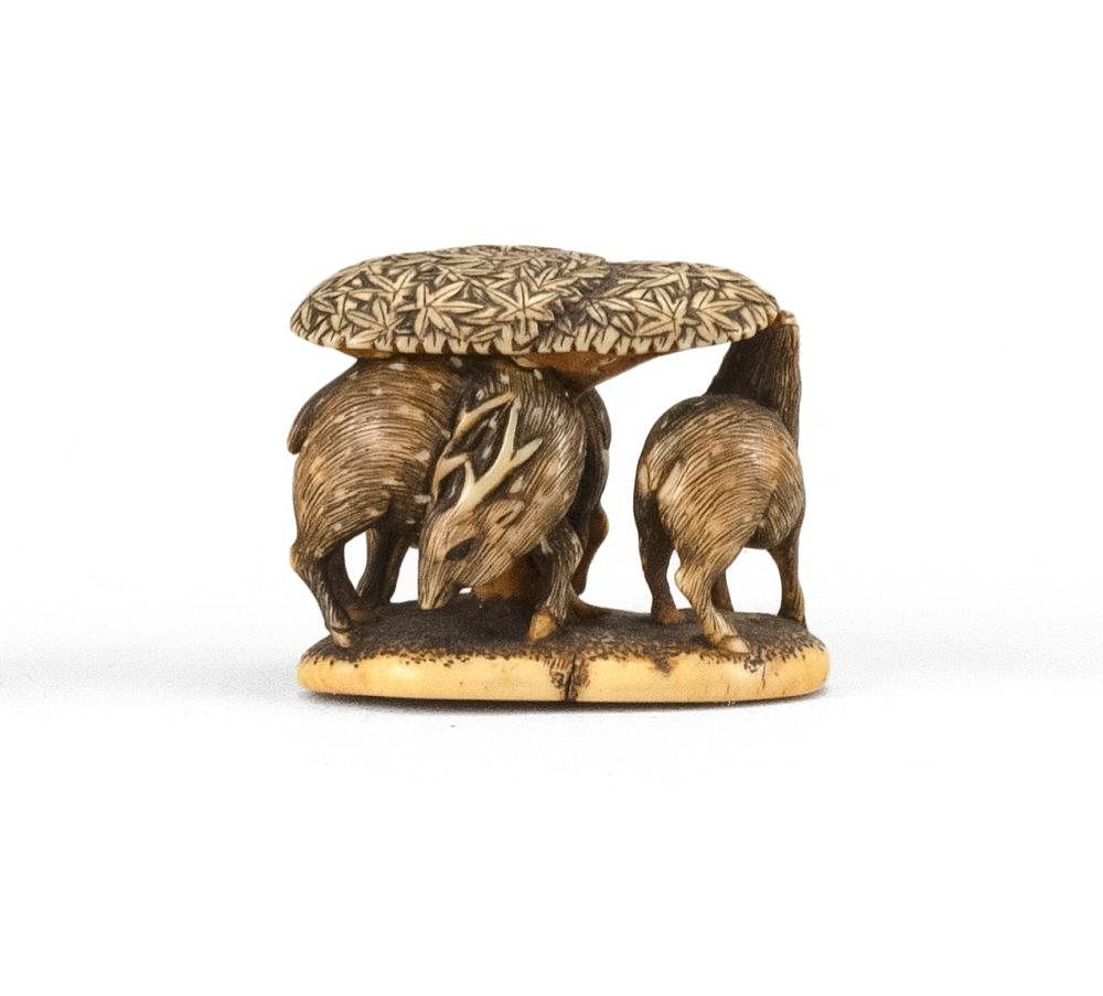 """JAPANESE IVORY NETSUKE By Masakazu (1868-1911). In the form of three deer beneath maple trees. Signed. Length 1.3"""". Not available fo..."""