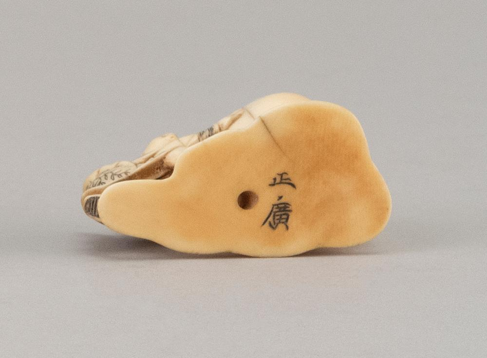 JAPANESE IVORY NETSUKE By Ryushinsai Masahiro. In the form of a karako playing with a daruma doll. Signed. Length 2.7