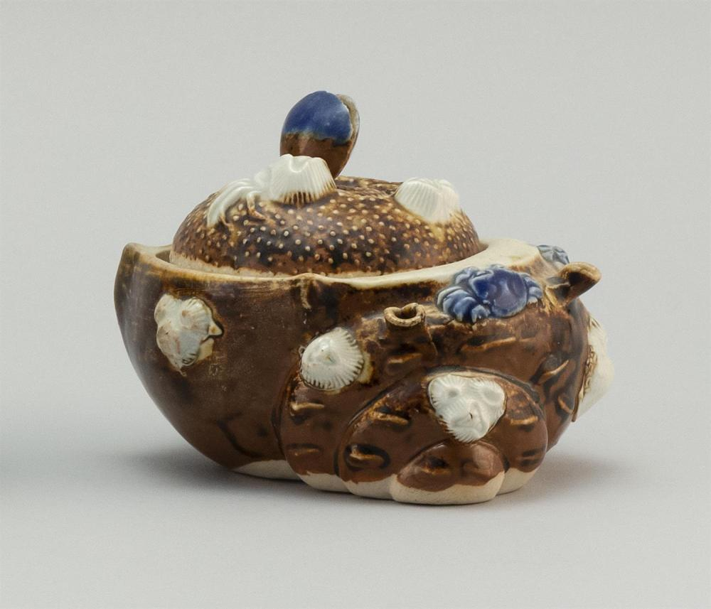 JAPANESE BROWN, BLUE AND WHITE HIRADO PORCELAIN JAR In shell form, accented with crabs, barnacles and other shells. One open shell c...