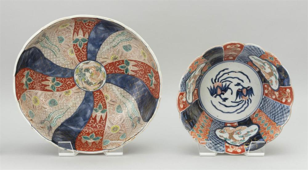 """TWO JAPANESE IMARI PORCELAIN BOWLS 1) With shaped rim, and decoration of a pinwheel design about a dragon center. Diameter 12.25"""". 2..."""
