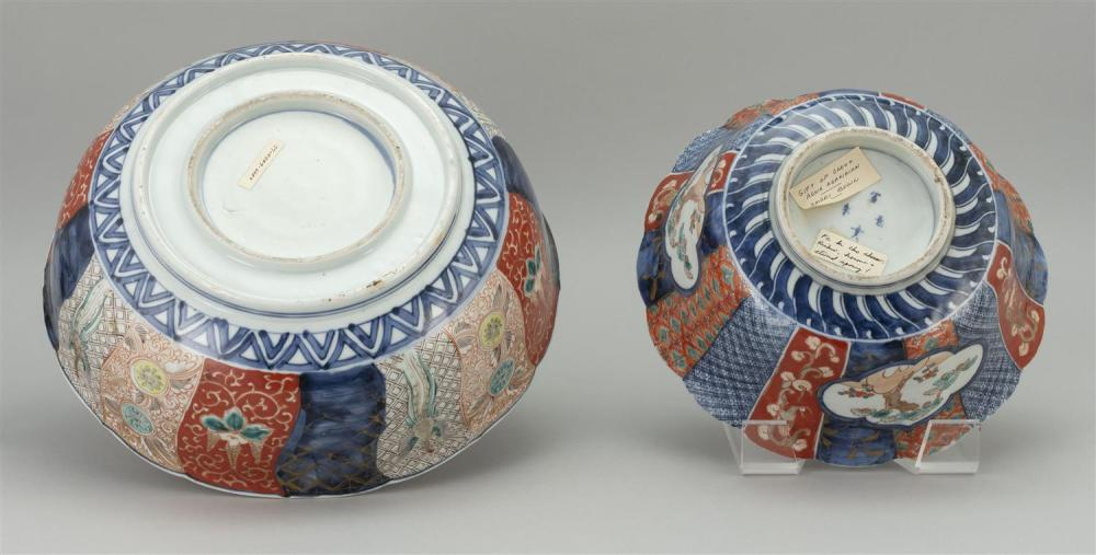 TWO JAPANESE IMARI PORCELAIN BOWLS 1) With shaped rim, and decoration of a pinwheel design about a dragon center. Diameter 12.25