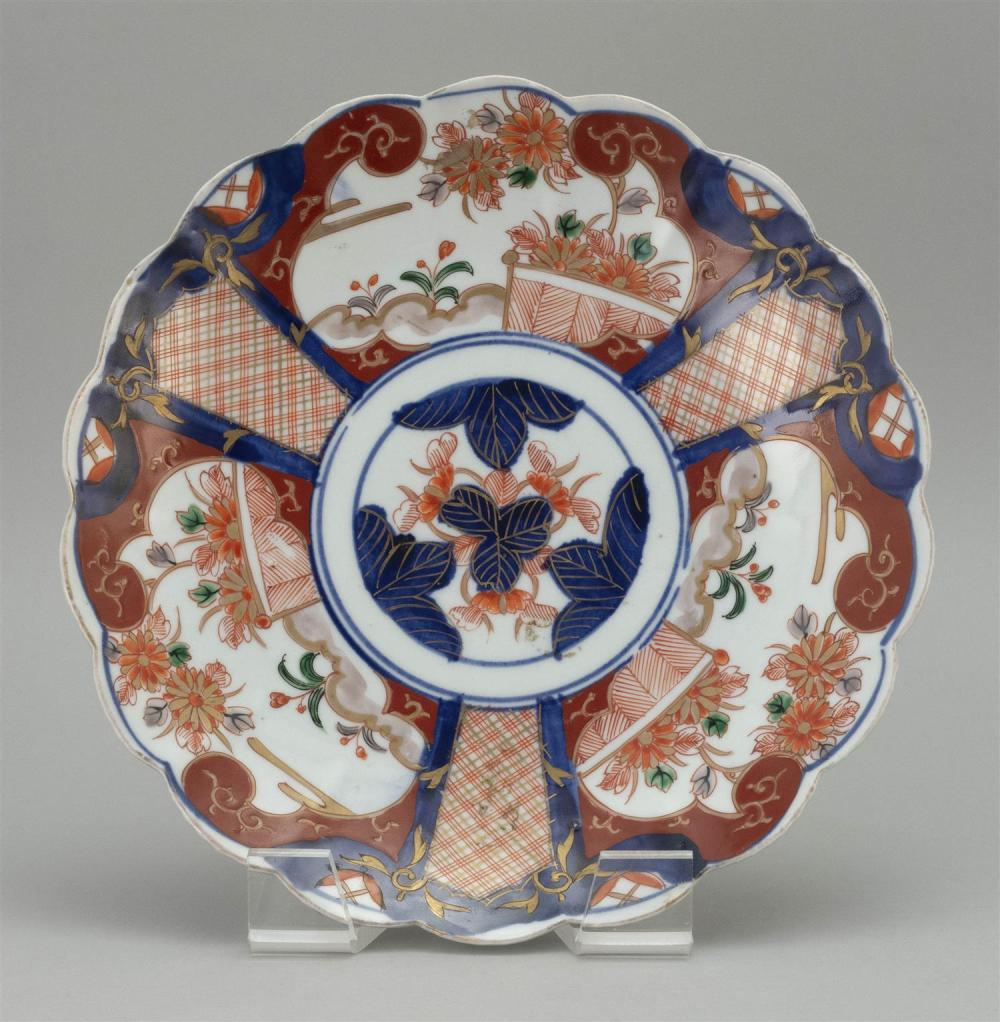 "JAPANESE IMARI PORCELAIN PLATE Floriform, with three floral cartouches around the sides. Diameter 11""."