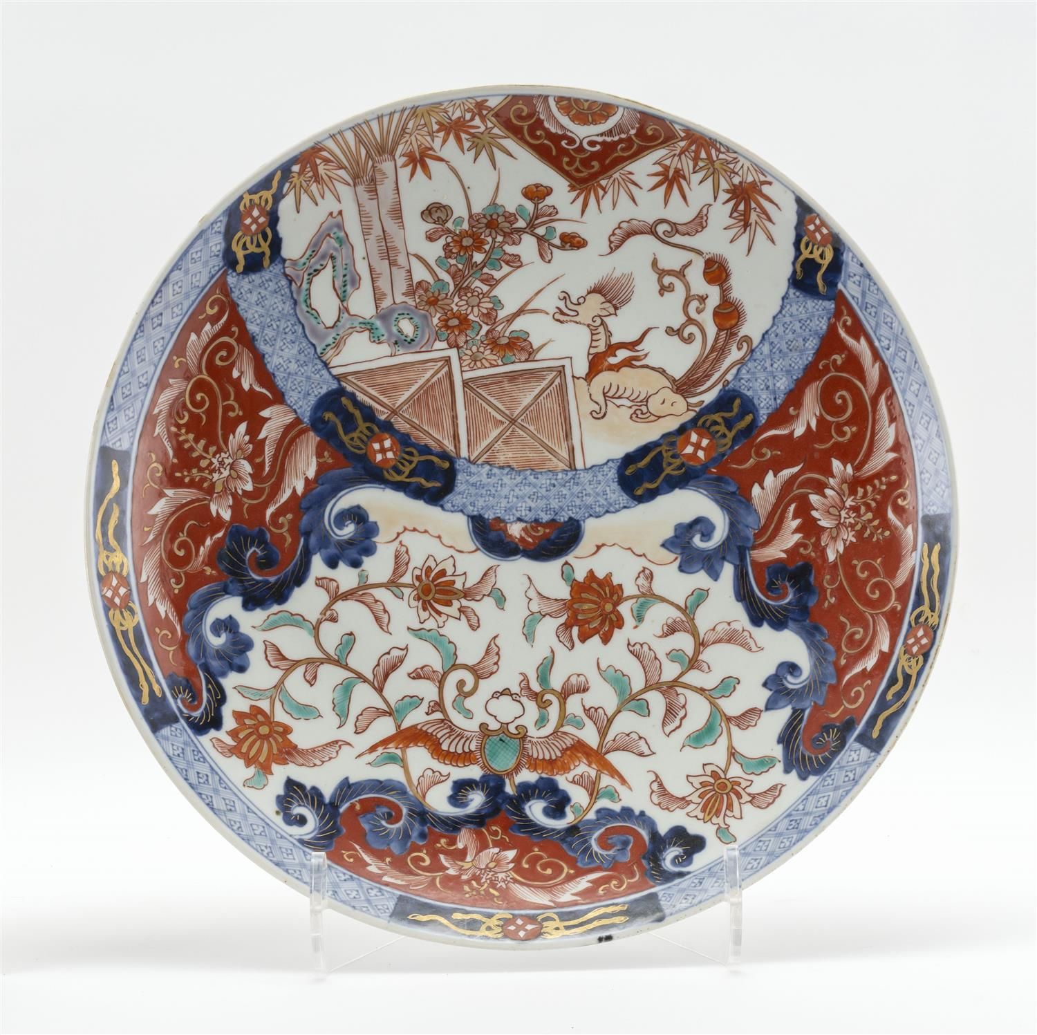 JAPANESE IMARI PORCELAIN CHARGER With decoration of a dragon in a garden landscape, and flowers and vines with gilt highlights. Diam...