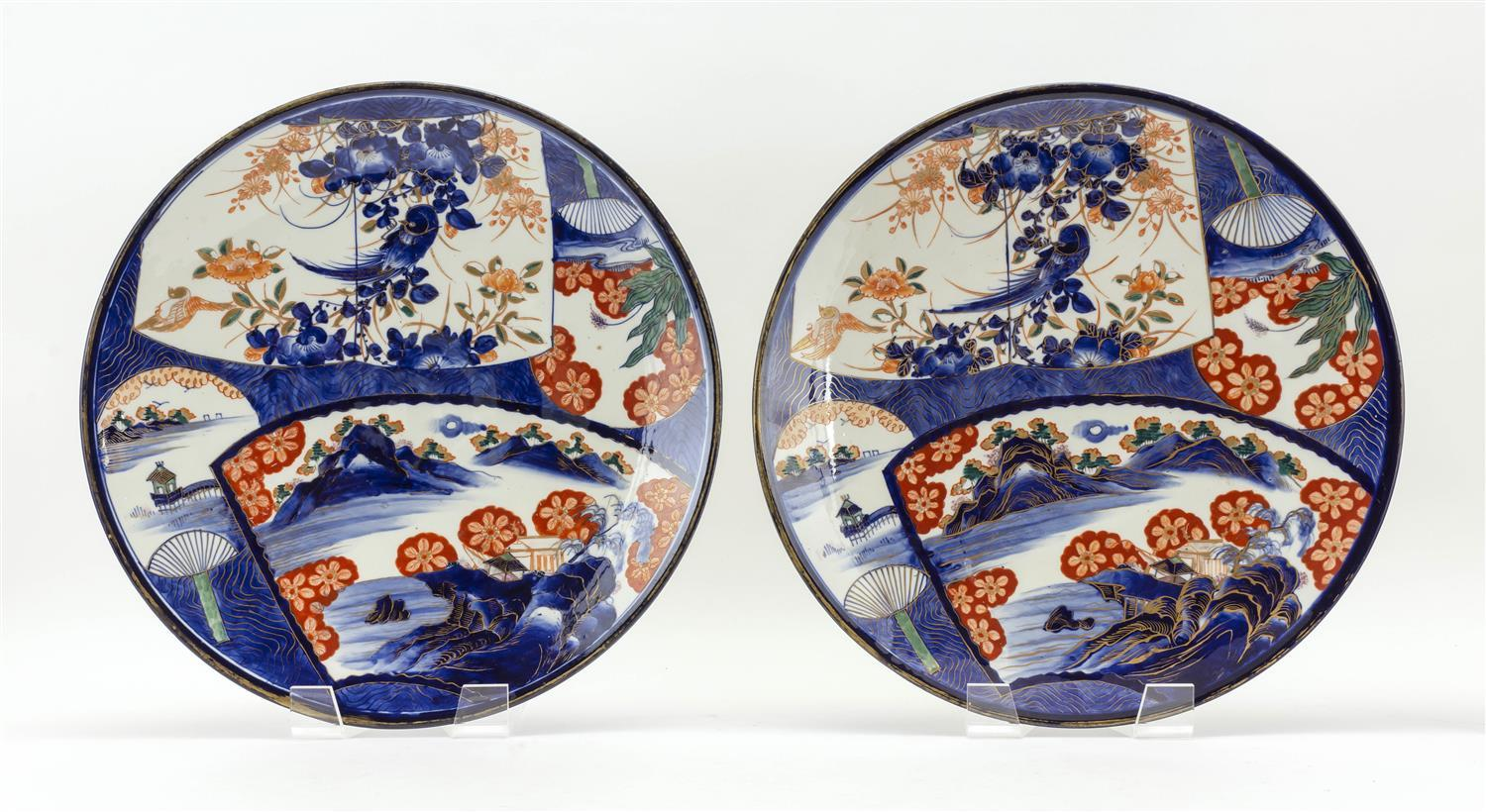 """PAIR OF JAPANESE IMARI CHARGERS With floral and landscape fan-shaped cartouches and gilt highlights. Diameters 16""""."""