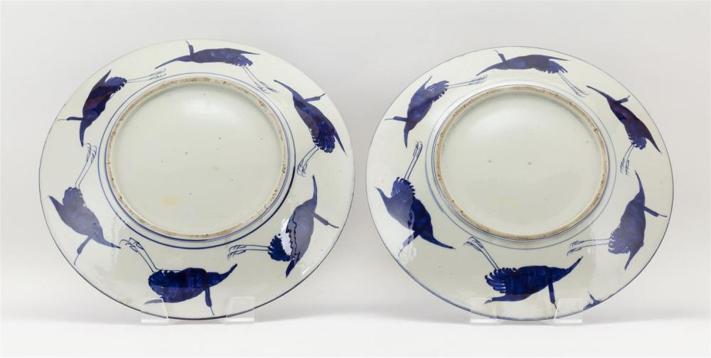 PAIR OF JAPANESE IMARI CHARGERS With floral and landscape fan-shaped cartouches and gilt highlights. Diameters 16